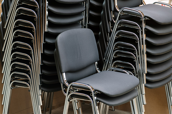 Leather and metal chairs stacked